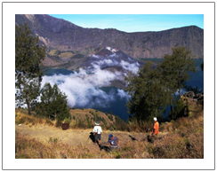 Crater rim of Senaru, Lake view from Senaru crater rim. Rinjani trekking via Senaru